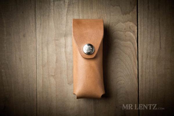 brown leatherman multi tool sheath with locking snap