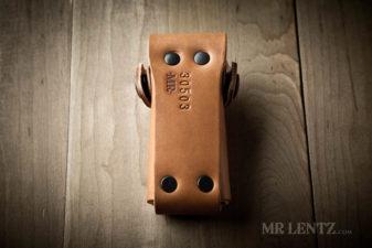 black rivets on brown leather sheath
