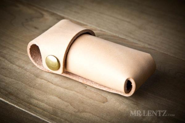 brass on tan leather tool sheath