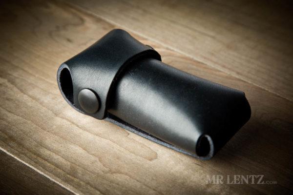 black snaps on black leather tool sheath